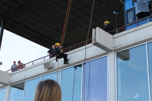 Ottawa Fire Fighter rappelling from the roof of Rideau Carleton Entertainment Centre