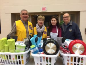 Lions Iva Cook and Doug Forbes participate in November 19, 2016 Drop Off Day.